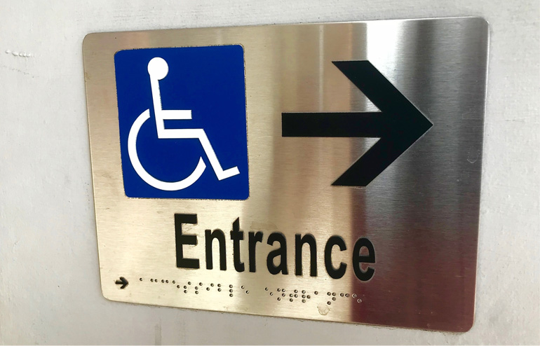 Easy to understand custom ADA sign by Surely Signs